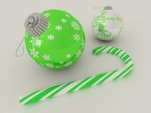 3D rinden de verde y de la chuchería de plata de la decoración del día de fiesta con el bastón de caramelo Imagen de archivo