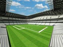 3D rinden del estadio de fútbol americano grande moderno hermoso con los asientos blancos Imágenes de archivo libres de regalías