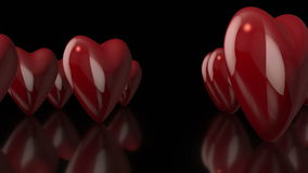 3D Rotating Love Hearts in Black Background stock video
