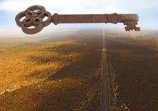 3D Rustic Key floating over barren landscape Royalty Free Stock Images