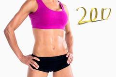 3D Samengesteld beeld van het vrouwelijke bodybuilder stellen met handen op heupen medio sectie Royalty-vrije Stock Foto