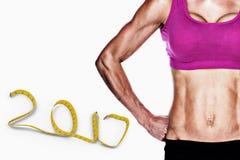3D Samengesteld beeld van het vrouwelijke bodybuilder stellen met handen op heupen medio sectie Royalty-vrije Stock Foto's