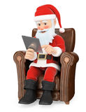 3D Santa Claus sitting on a sofa with a tablet Royalty Free Stock Photography
