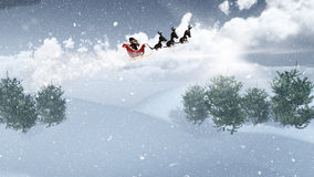3D Santa and his sleigh flying over a snowy landscape Royalty Free Stock Photography