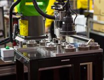 Automation Assembly Machine. 2D sensor robotic machine assembly gears Stock Image