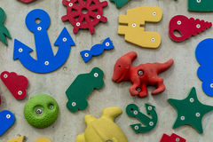 3D shapes and icons on a wall Stock Photography