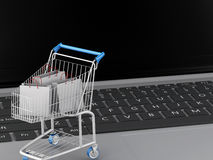 3d Shopping cart on Laptop. e-commerce  concept Royalty Free Stock Photos