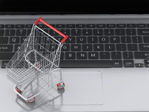 3d Shopping cart on Laptop. e-commerce concept Royalty Free Stock Photography