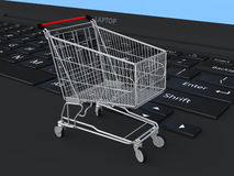 3d shopping trolley on laptop Stock Photos