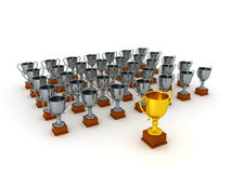 3D Silver Trophies and One Gold Trophy Stock Photo