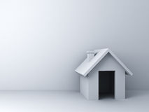 3d simple house model over white wall background with blank space Royalty Free Stock Photo