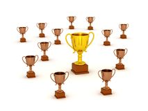 3D Small Bronze Trophy and Large Gold Trophy. A large 3D golden trophy surrounded by many smaller bronze trophies. Isolated on white background Stock Photography