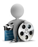 3d small people - cinema clapper and film tape. 3d small person standing next to cinema clapper and film tape 3d image. White background Royalty Free Stock Photos