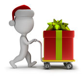 3d small people - Santa carries a gift. 3d small person - Santa carries a big gift on trolley. 3d image. White background Royalty Free Stock Image