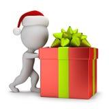 3d small people - Santa pushing a gift Stock Photo
