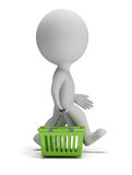 3d small people - shopping basket. 3d small person goes with a green shopping basket. 3d image. White background Stock Photography