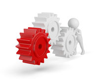 3d small person rolls a large gears Royalty Free Stock Photo