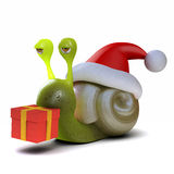 3d Snail dressed as Santa carrying a Christmas gift Royalty Free Stock Image