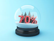 3d Snow dome with trees and red 70% discount. 3d renderer image.  Snow dome with trees and red 70% discount. Winter sale concept Royalty Free Stock Images