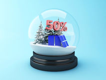 3d Snow dome with trees and red 50% discount. 3d renderer image.  Snow dome with trees and red 50% discount. Winter sale concept Stock Image