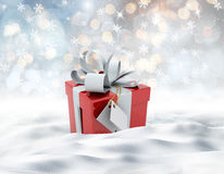 3D snowy landscape with Christmas gift nestled in snow Stock Images
