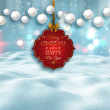 3D snowy landscape with decorative Christmas label and baubles Royalty Free Stock Images