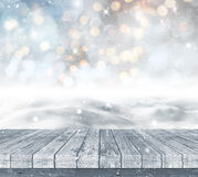 3D snowy landscape with wooden decking Royalty Free Stock Photography