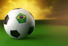 3d soccer ball with Brazil flag on green grass. And dramatic sky background Royalty Free Stock Images