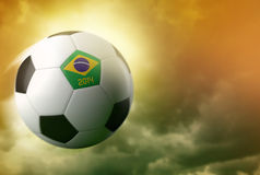 3d soccer ball with Brazil flag on sky background. 3d soccer ball with Brazil flag in action on dramatic sky background Stock Photo