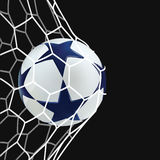 3D Soccer ball in net. Football ball with blue stars on black background. Royalty Free Stock Image