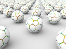 3D soccer balls array. 3D render illustration of multiple 3D soccer balls arranged in a linear pattern over a white background with shadows Royalty Free Stock Photography