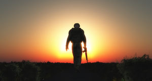 3D soldier walking at sunset Stock Photo