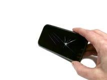 Dé sostener el teléfono móvil negro genérico con la pantalla quebrada aislado Fotografía de archivo