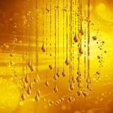 3D specificerad illustration av en droppe av guld- färg för vatten Fotografering för Bildbyråer