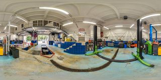 3D spherical panorama with 360 degree viewing angle of service station with a jack. Ready for virtual reality in vr. Full equirect stock images