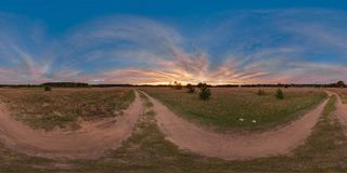 3D spherical panorama with 360 viewing angle. Ready for virtual reality or VR. Full equirectangular projection. Sunset in the fiel. D. Road in the field stock photography