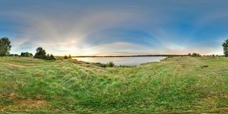 3D spherical panorama with 360 viewing angle. Ready for virtual reality or VR. Sunrise at the bank of lake. Fresh green. 3D spherical panorama with 360 viewing royalty free stock image