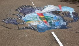 3D street anamorphic painting on asphalt in a park.  Asphalt art concept. Maldives, Hulhumale town. 04.19.2018 Royalty Free Stock Image