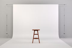 3d studio setup with wooden chair and white background Royalty Free Stock Image