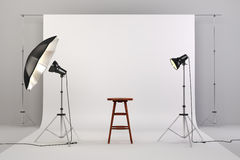 3d studio setup with wooden chair and white background. Computer generated vector illustration