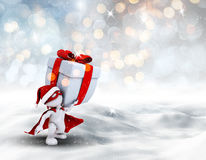 3D superhero Christmas figure carrying gift. 3D render of a superhero Christmas figure carrying gift through a snowy landscape Stock Photo