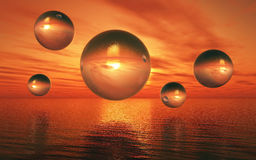 3D surreal landscape with glass spheres over sea. 3D render of a surreal landscape with glass spheres hovering over a sunset sea Royalty Free Stock Photos