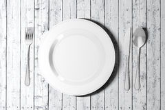 3d table setting with white empty plate and cutlery Stock Image