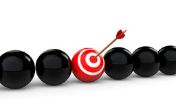 3d target ball with an arrow among black balls Stock Photography