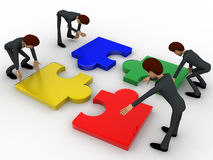3d team of men solve puzzle concept Royalty Free Stock Photo