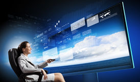 3 d technologies. Young businesswoman in chair near tv screen with click royalty free stock photography