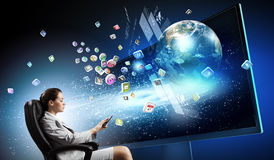 3 d technologies. Young businesswoman in chair near tv screen with click. Elements of this image are furnished by NASA stock photography