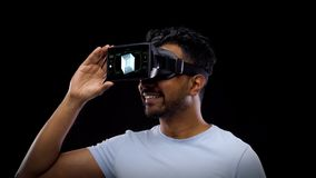 Man in virtual reality headset with cubic hologram stock video