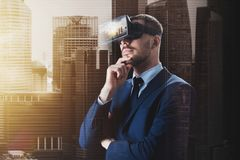 Businessman in virtual reality glasses or headset. 3d technology, virtual reality, cyberspace and augmented reality concept - young businessman with singapore Royalty Free Stock Images