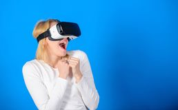 3d technology, virtual reality, entertainment, cyberspace and people concept. Happy woman exploring augmented world. Interacting with digital interface royalty free stock images